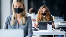 Office workers at desk in face mask
