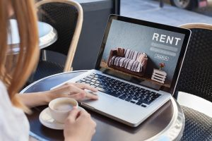 Searching for rental property on laptop